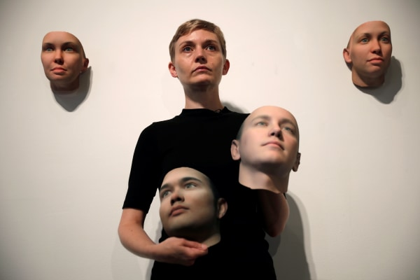 Image: Artist Heather Dewey-Hagborg poses with various 3-D printed masks created from DNA extracted from cheek swabs and hair clippings she received from formerly imprisoned U.S. Army Private Chelsea Manning ahead of exhibition in New York