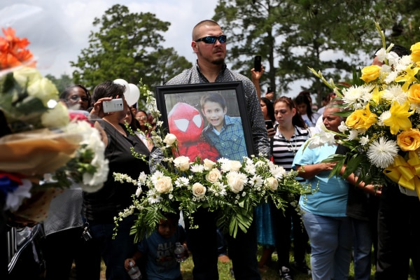 Flowers and a photo of Josue Flores to be placed at his grave site