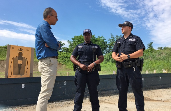 Image: Lester Holt talks to Kayan Dawkins and Gregory Wallce