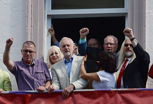 Image: Jeremy Corbyn watches the annual Durham Miners' Gala from a hotel balcony