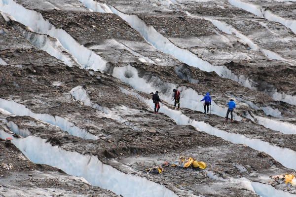 Image: A specialized eight-person recovery team searches for aircraft wreckage