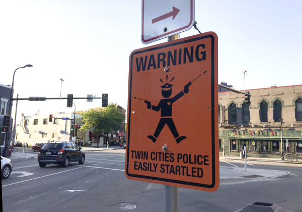 Image: Sign mocking Minneapolis police