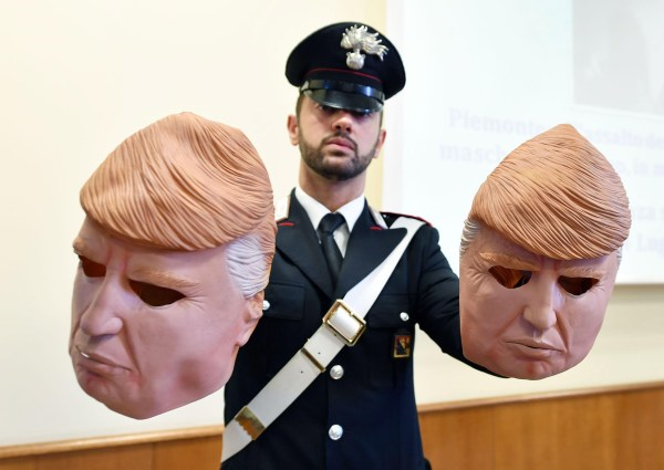 Image: Two brothers wearing Trump masks arrested in Turin