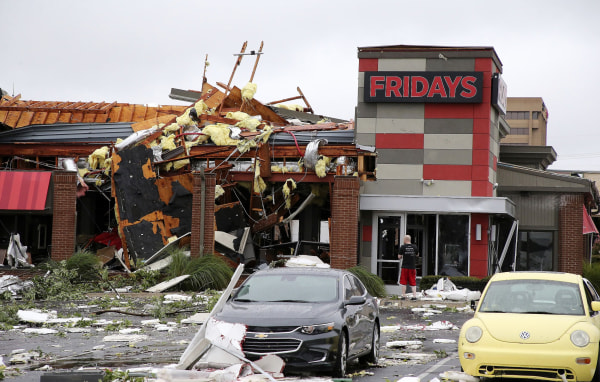 Image: A man stands outside a Fridays restaurant after a storm moved through the area in Tulsa, Oklahoma, Aug. 6, 2017. A possible tornado struck near midtown Tulsa and causing power outages and roof damage to businesses.