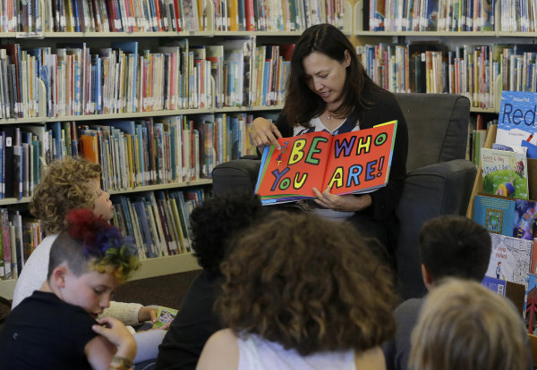Image: Sandra Collins, executive director and founder of enGender, reads a book to campers at the Bay Area Rainbow Day Camp in El Cerrito, Calif.