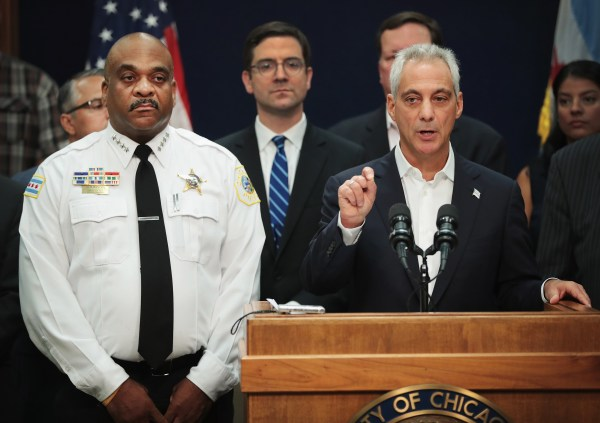 Image: Chicago Mayor Rahm Emanuel, right, stands with Chicago Corporation Counsel Ed Siske, center, and Chicago Police Department (CPD) Superintendent Eddie Johnson as he announces that the City of Chicago will file a federal lawsuit