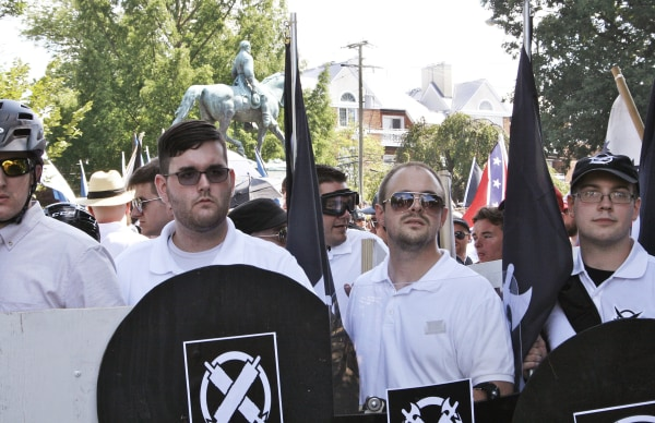 Image: James Alex Fields Jr., second from left, holds a black shield during a white supremacist rally in Charlottesville