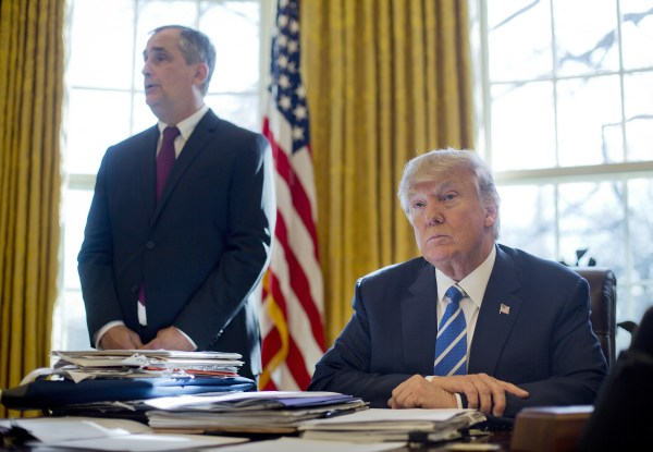 Image: President Donald Trump listens as Intel CEO Brian Krzanich speaks in the Oval Office of the White House