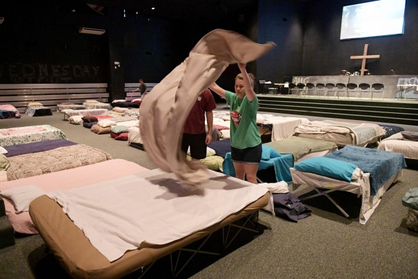Image: Youths in a shelter for volunteer rescue workers set up at the Fairfield Baptist Church student building on Aug. 29, 2017 in Cypress, Texas.