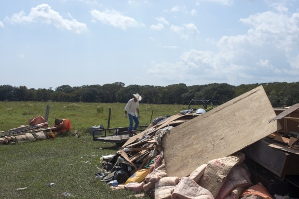 Image: The Reed family clear out their house near Bay City, Texas