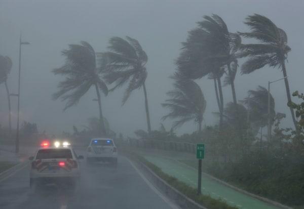 Image: Police patrol the area as Hurricane Irma slams across islands in the northern Caribbean on Wednesday, in San Juan