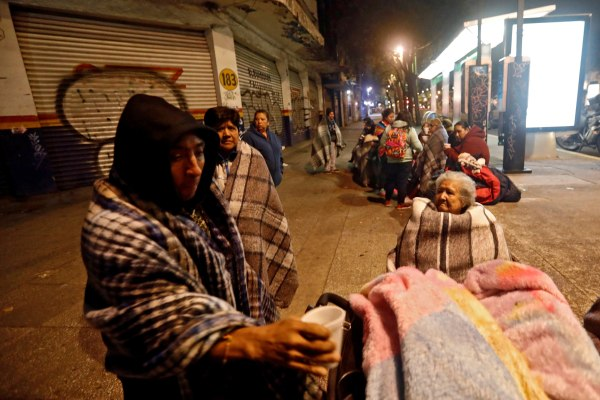 Image: People gather on a street after an earthquake hit Mexico City