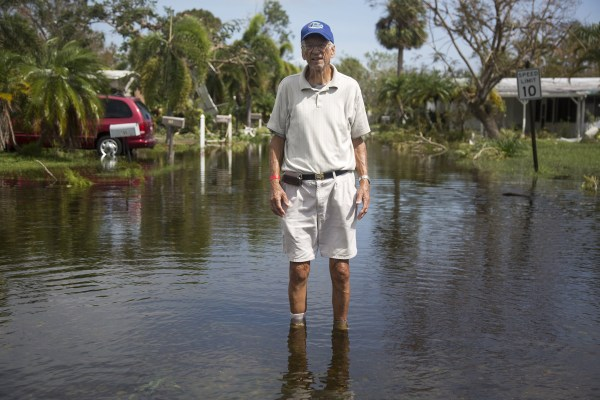 Image: Richard Nowak surveys the damage to his home in Holiday Manor in Naples
