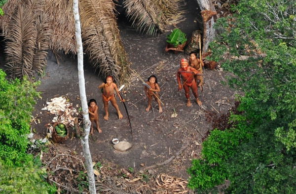 Image: uncontacted Indians seen from a Brazilian government's observation aircraft in the Brazilian Amazon forest, near the border with Peru
