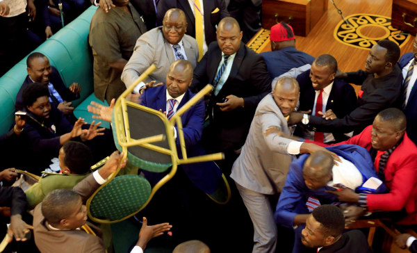 Image: Ugandan lawmakers involve in a fight in the parliament ahead of proposed age limit amendment bill debate a move to change the constitution to extend the president's rule, in Kampala