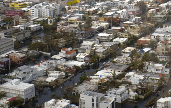 Image: Buildings are surrounded by flood water in San Juan