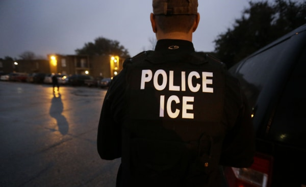 Image: U.S. Immigration and Customs Enforcement agents during an early morning operation in Dallas.