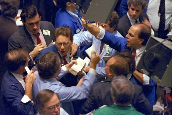 Image: Traders work on the floor of the New York Stock Exchange as panic selling swept Wall Street