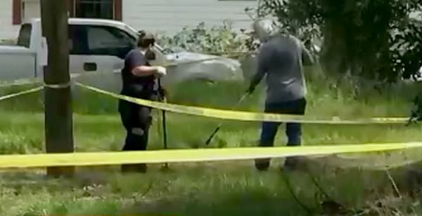 Image: A crime scene is investigated as part of a potential serial killer pattern in Tampa, Florida.