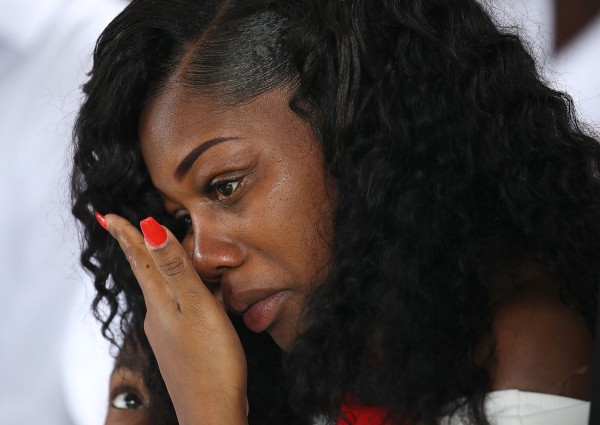 Image: Myeshia Johnson wipes away tears during the burial service for her husband
