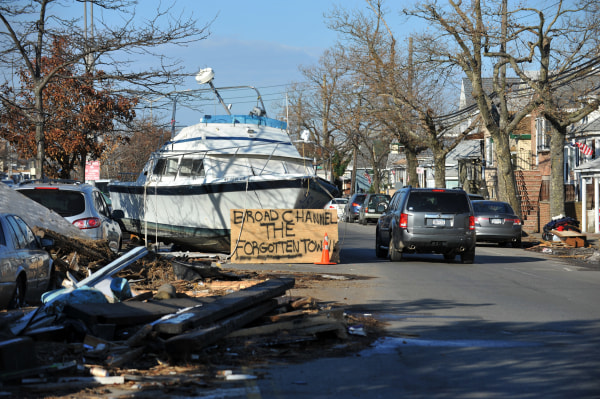 Image: A boat and other debris lay in Broad Channel after Sandy in 2012.