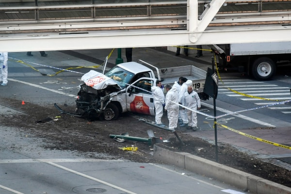 Image: Investigators inspect a truck following a shooting incident in New York