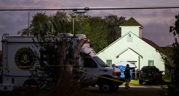 Image: An FBI agent works in front of the First Baptist Church on Nov. 6, 2017, where a gunman opened fire on a Sunday service in Sutherland Springs, Texas.