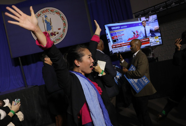 Image: Hyun Lee, a supporter of Democratic gubernatorial candidate Ralph Northam celebrates