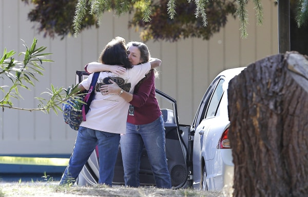 Image: Two women embrace outside Rancho Tehama Elementary School