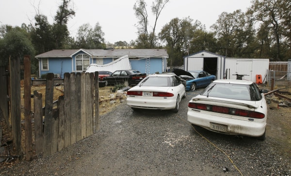 Image: Cars are parked in front of the home of Kevin Janson Neal