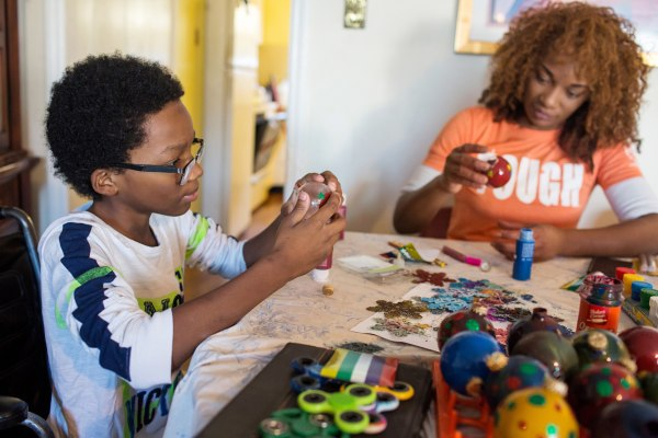 Image: Roland Williams, 11, makes Christmas ornaments with his mother