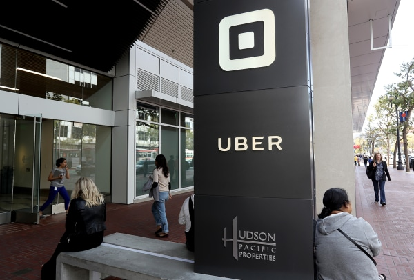 Image: The logo of the ride sharing service Uber is seen in front of its headquarters
