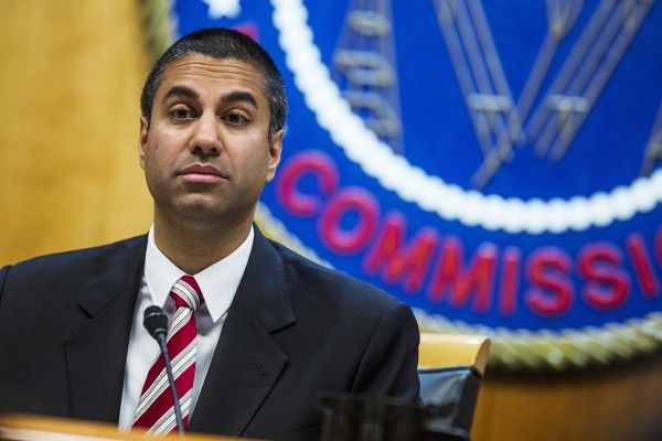 Ajit Pai, chairman of the Federal Communications Commission (FCC), pauses while speaking during an open meeting in Washington, D.C. on Nov. 16, 2017. The FCC plans to vote in December to kill the net neutrality rules passed during the Obama era. Zach Gibson / Bloomberg via Getty Images file