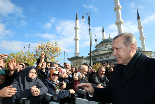 Image: Turkish President Erdogan greets his supporters after the Friday prayers in Ankara