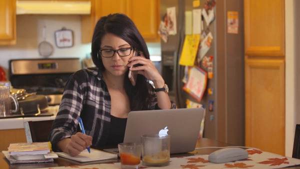 Image: Desiree Bercilla calls local pharmacies to find the best price on a prescription drug.