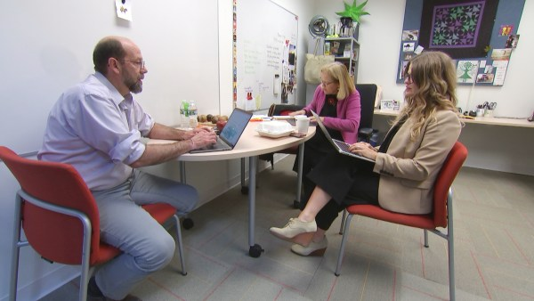 Image: Lisa Gill and colleagues discuss results of their prescription pricing survey.