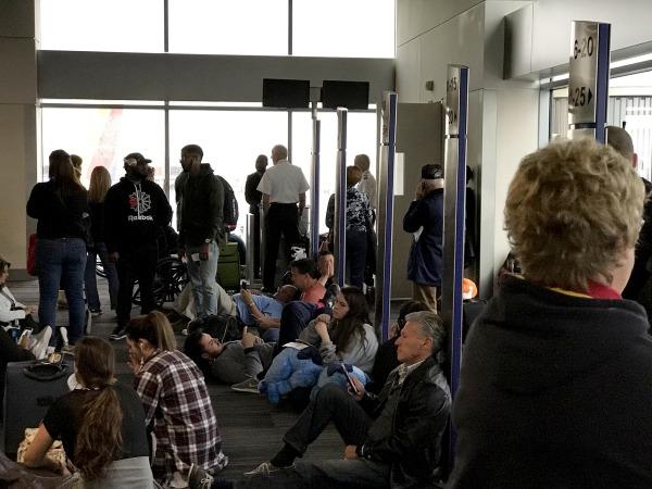 Image: Passengers sit stranded at the Atlanta airport, Dec. 17, 2017.