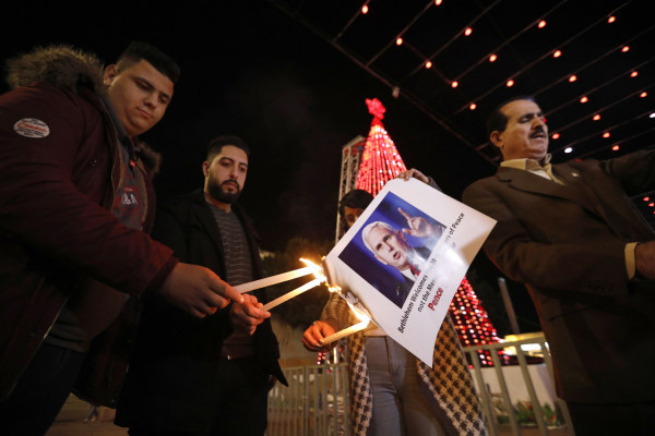 Image: Palestinians burn the picture of U.S. Vice President Mike Pence during a protest against Trump's decision to announce Jerusalem as the capital of Israel and amid the expected visit of Pence in the West Bank city of Bethlehem, Dec. 17, 2017.