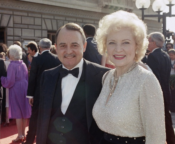Image: John Hillerman, left, and Betty White, right, arriving at Emmy Awards in Pasadena, California on Sept. 22, 1985.