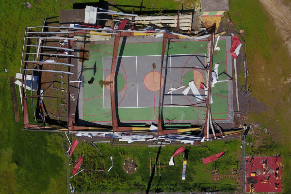 Image: The roof of a basketball court was destroyed in the Punta Santiago beachfront neighborhood of Humacao