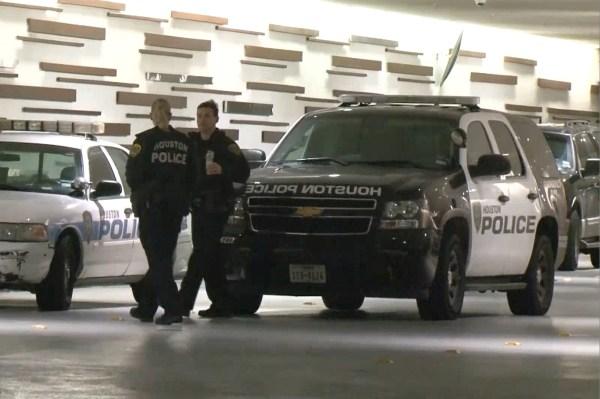 Image: Police talk outside the Hyatt Regency hotel in Houston