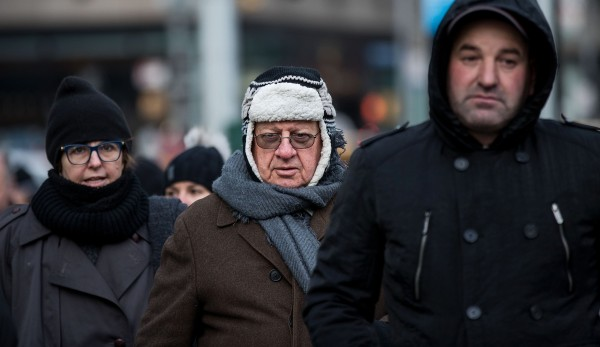 Image: Bundled up pedestrians walk through Midtown Manhattan
