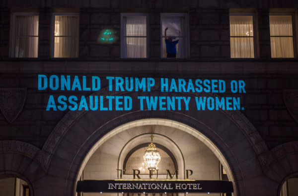 Image: A projection by Artist Robin Bell is seen on the side of the Trump International Hotel