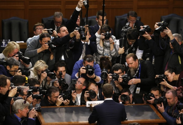 Image: Facebook CEO Zuckerberg arrives to testify before a U.S. Senate joint hearing on Capitol Hill in Washington