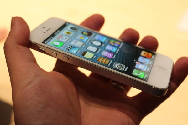 white iPhone 5 in hand