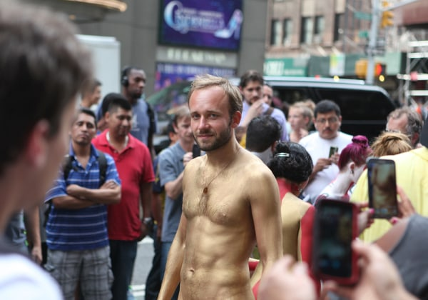 Kirill, a nudist, participates in a public body painting event by artist Andy Golub near New York's Times Square on July 31, 2013.