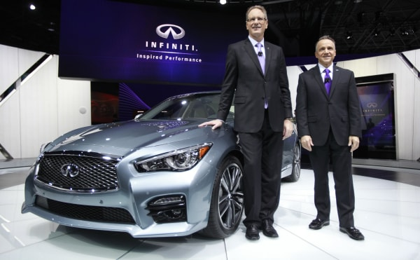 Johan De Nysschen, president of Infiniti Motor Motor Company, and Ben Poore, president of Infiniti Americas pose with the Infiniti.