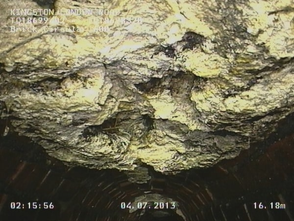 A CCTV still shows the 15-ton mass of wet wipes and cooking fat that was found clogging sewers under London.