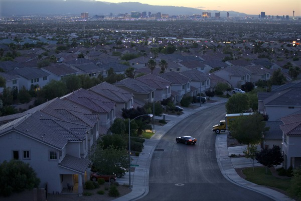 In this Wednesday, May 29, 2013, photo a motorist pulls into the driveway in a neighborhood in Henderson, Nev. Freddie Mac reports on mortgage rates f...