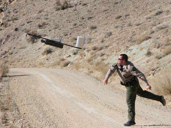 Deputy Danny Norris of the Mesa County Sheriff's Office in Colorado, launching a Falcon drone off his shoulder during a test run. It is illegal to damage the property of the sheriff's office — and that would include shooting down its drones.